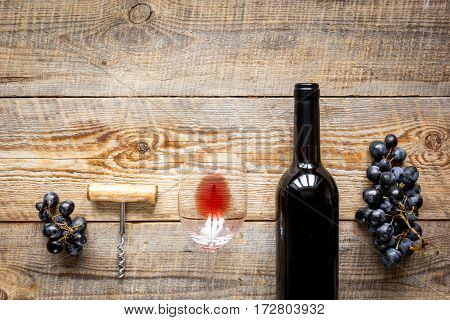 Glasses of red wine and bottle on wooden table background top view mockup