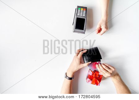 payment by credit card for gift in box in shop on white desk background mock up