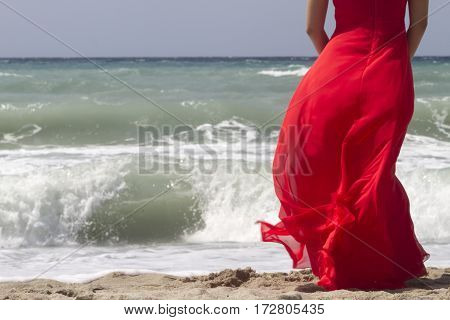 Beautiful Red Dress Flowing In The Wind At The Beach. Cropped.