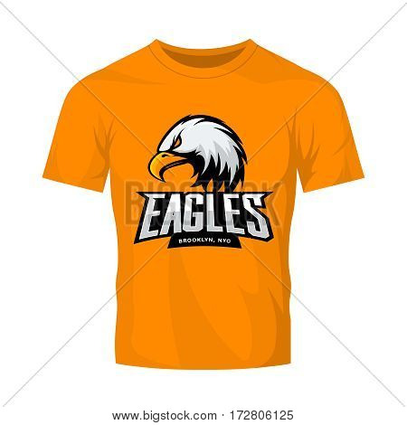 Furious eagle sport vector logo concept isolated on orange t-shirt mockup. Modern web infographic New York Brooklyn team pictogram. Premium quality wild bird t-shirt tee print illustration