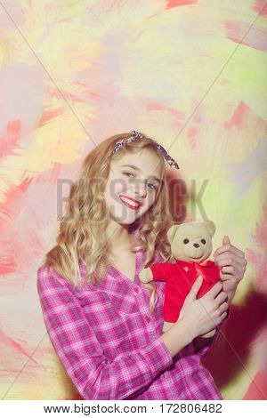 Happy Pretty Girl Smiles With Cute Teddy Bear In Red