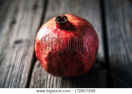 pomegranate on a wooden rustic background. fruit food look for useful
