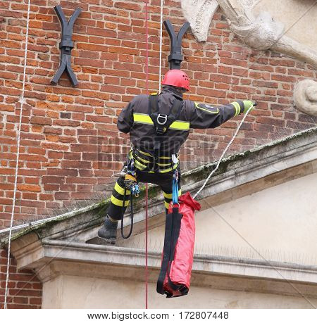 Brave Firefighters Climbing With Ropes And Climbing Equipment On