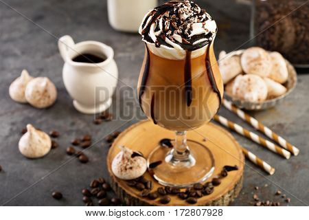 Iced coffee with whipped cream and chocolate syrup
