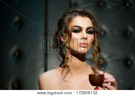 Pretty Girl Drinks Coffee In Cafe