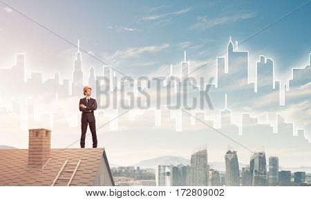 Young businessman in suit and safety helmet on roof edge. Mixed media.