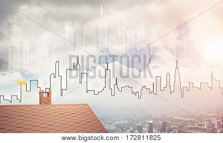 Brick house roof and modern cityscape at background