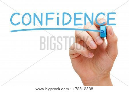Hand writing Confidence with blue marker on transparent glass board.