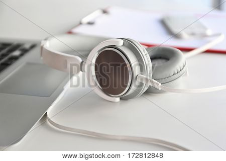 Headphones and laptop on office table