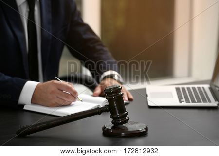 Modern workplace with judge gavel on table