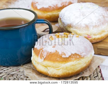 Tasty donuts with powdered sugar and icing