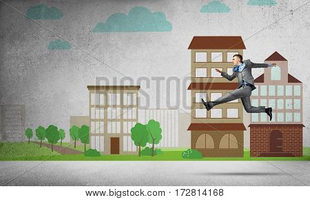 Young businessman in city running in a hurry.