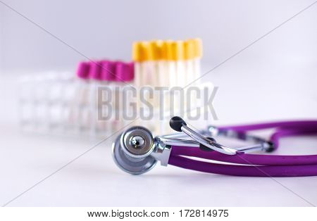 stethoscope near medical tubes on white background.