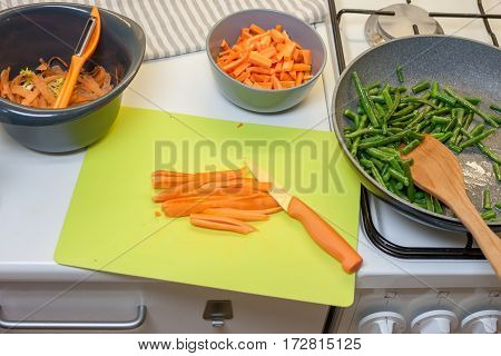 cooking vegetables carrot and green beans at home kitchen