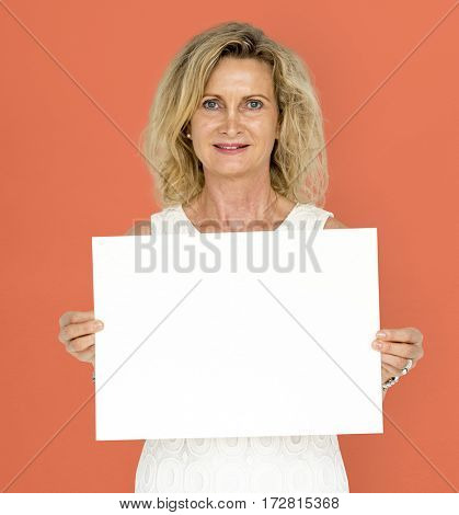 Caucasian blonde woman holding placard