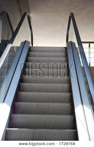 Moving staircase inside a shopping center in Maia (Portugal). poster