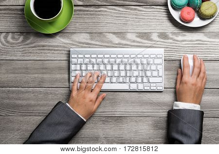 Top view of businesswoman hands using keyboard and mouse