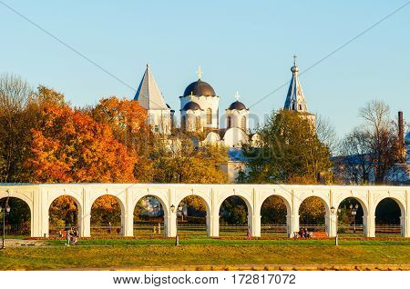 Architecture landscape of Veliky Novgorod, Russia- arcade of Yaroslav Courtyard ancient St Nicholas cathedral and people walking along in Veliky Novgorod Russia