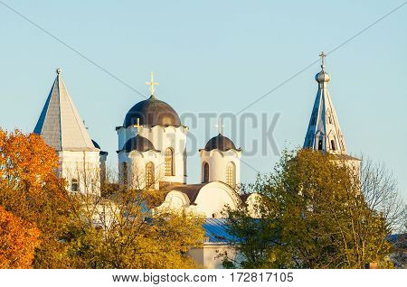 Veliky Novgorod, Russia - architecture autumn landscape. Architecture landmark - domes of St Nicholas cathedral and towers of Yaroslav courtyard in Veliky Novgorod Russia