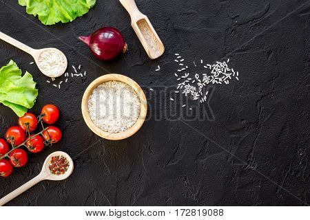 ingredients for paella on dark background top view.