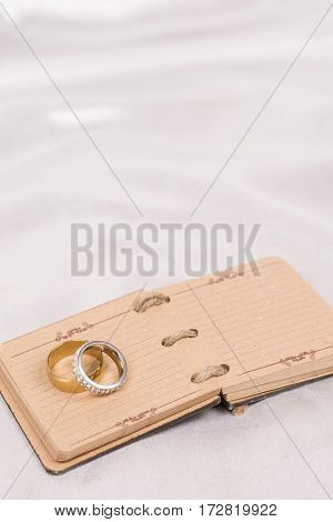 Flat Lay Wedding Rings On The Rustic Paper