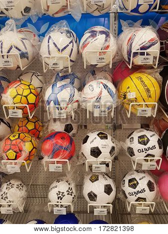CHIANG RAI THAILAND - FEBRUARY 15 : various brand of soccer ball in packaging for sale on supermarket stand or shelf on February 15 2017 in Chiang rai Thailand.