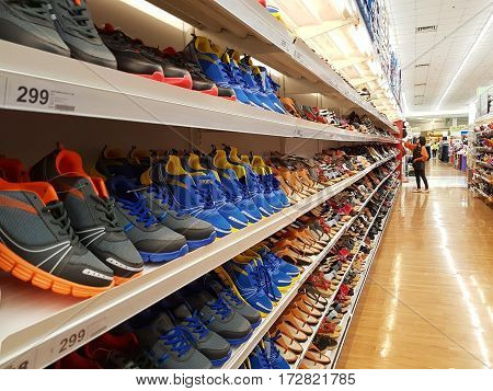 CHIANG RAI THAILAND - FEBRUARY 15 : various brand of shoes in packaging for sale on supermarket stand or shelf on February 15 2017 in Chiang rai Thailand.