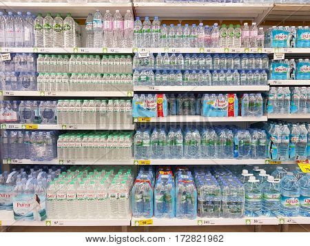 CHIANG RAI THAILAND - FEBRUARY 15 : various brand of mineral water in packaging for sale on supermarket stand or shelf on February 15 2017 in Chiang rai Thailand.