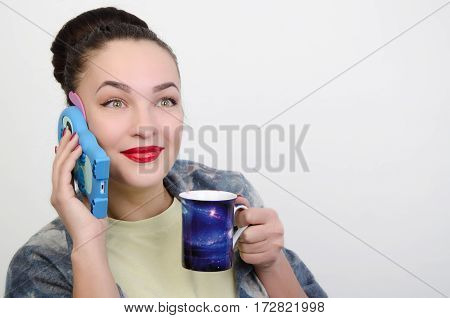 girl with  a blue telephone and cup