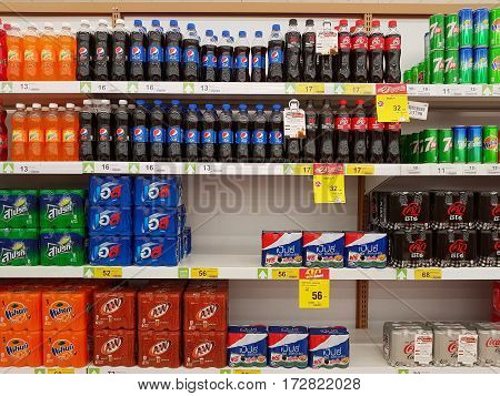 CHIANG RAI THAILAND - FEBRUARY 15 : various brand of cola in bottles for sale on supermarket stand or shelf on February 15 2017 in Chiang rai Thailand.