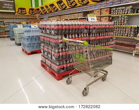 CHIANG RAI THAILAND - FEBRUARY 15 : various brand of cola in bottles for sale with pushcart in supermarket on February 15 2017 in Chiang rai Thailand.