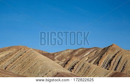 Geological layers of earth - layered rock background. Detail of high Atlas mountains in Morocco