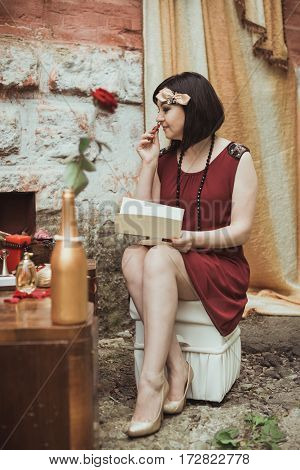 retro girl sitting at a dressing table with a letter in your hands