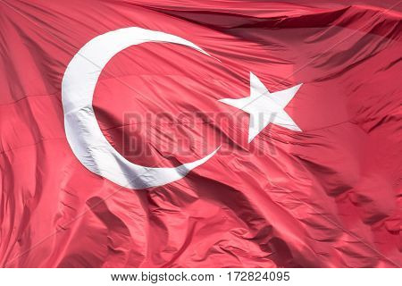 Picture of the official turkish flag hoisted in a windy environment