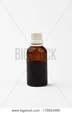 Bottle with cough medicine. White cap on brown vial. Be healthy and feel good.