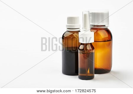 Set of bottles with medicine. Liquid remedy in vials. Home treatment for flu.