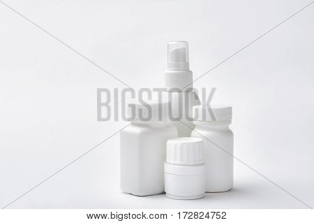 White vials with medicine. Drug containers isolated. Remedy for headache.