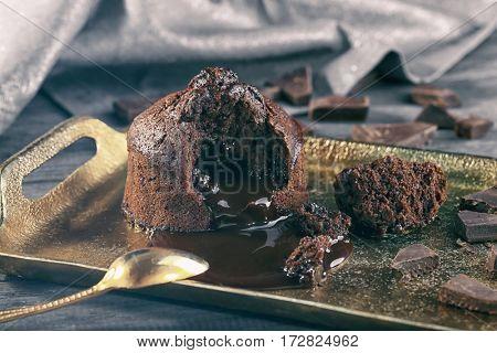 Tasty chocolate fondant on tray