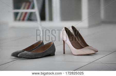 Changing shoes concept. Female shoes  at office
