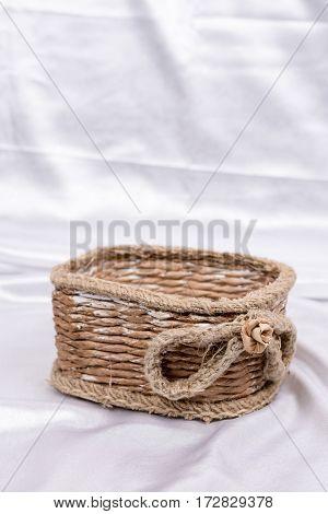 Brown Retro Rustic Woven Basket Over White Satin