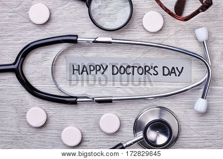 Stethoscope, tablets, modifier and glasses. Professional medical holiday.