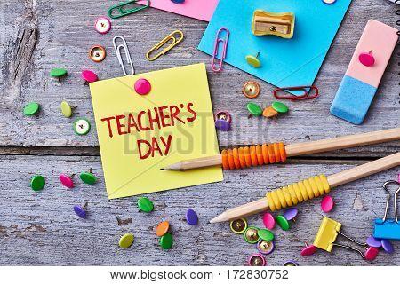 Buttons, erazer and sharpener. Warm congratulation on Teacher's Day.