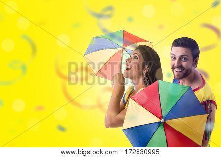 Couple dancing Frevo on yellow