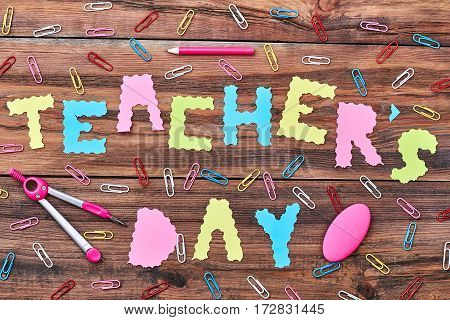 Paper clips, pencil and eraser. Greeting with Teacher's Day.