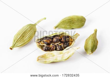 Green cardamon seeds isolated on white background.