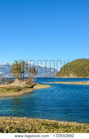 Fantastic view over ocean, snow mountain and rocks at Furry Creek Dive Site in Vancouver, Canada. Island.