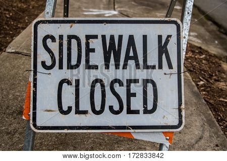 Sidewalk Closed Sign Fills Frame in construction zone