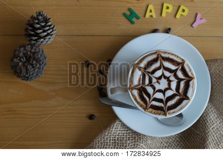 hot coffee with star chocolate whipped-cream and coffee bean happy sign on wooden table in coffee shop
