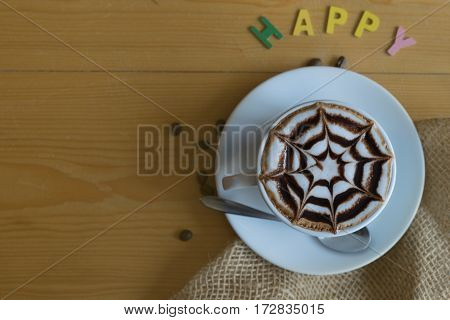 hot coffee and happy sign on wooden table