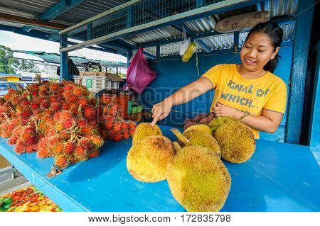 Menumbok,Sabah-Aug 19,2016:Villager selling various kind of exotic tropical fruits like rambutan & tarap in Menumbok,Sabah.Local market known as tamu offering variety Southeast Asian tropical fruits.